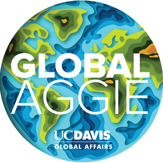 A circular Global Aggie logo with a graphic of the globe
