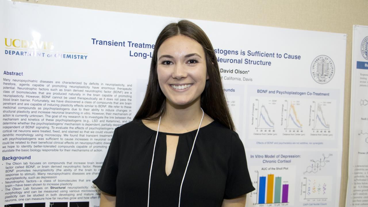 Alexandra Greb in front of her Academic Poster