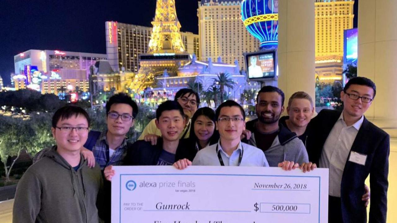Team Gunrock posing with a $500,000 giant check for the Amazon Alexa Prize in Las Vegas